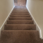 Stairs carpet with hallway vinyl fitted